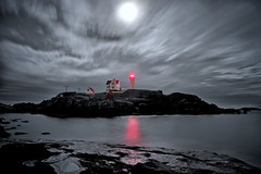 Night Skies over the Nubble Lighthouse - in explore (SunnyDazzled) Tags: york longexposure light red sky moon lighthouse reflection beach station night clouds lens stars island coast skies maine rocky full moonlight shores nubble