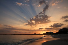 Sunburst over Grace Bay (Rob Shenk) Tags: ocean morning sun beach clouds sunrise island warm resort tropical sunburst rays turkscaicos turksandcaicos gracebay