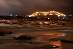 International Bridge (AnthonyC Photography) Tags: longexposure light water rock night lights rocks trails moonlight whitefish saultstemarie internationalbridge trailingwater