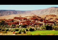 Passing the village (Bjrn Giesenbauer) Tags: trees village morocco faketiltshift