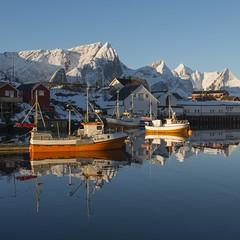Boats of a feather...... (Arjan van Hof) Tags: winter snow norway harbour peaks lofoten montains norninglight