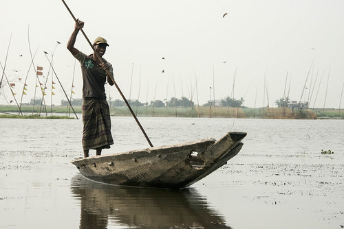 A fisherman in Sunamganj, Bangladesh. Photo by Finn Thilsted, 2013.