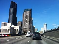 Seattle freeway (darth_sweder) Tags: road seattle usa america us washington downtown driving skyscrapers towers freeway suv seattlemunicipaltower columbiacenter 2013