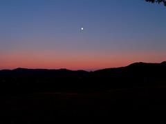 Eccola! (SoleTempesta) Tags: tramonto sunset moon luna cielo sky colors soletempesta colori blu monti sagome colline collina hills hill mountains piemonte italia italy