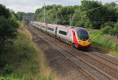 Virgin Trains Pendolino class 390 with 1S42 London Euston to Glasgow Central approaches bridge 60A at Standish on the West Coast Main Line on a sunny 23rd July 2016.  (steamdriver12) Tags: virgin trains pendolino class 390 1s42 london euston glasgow central approaches bridge 60a standish west coast main line wcml sunny summer saturday 23rd july 2016