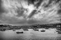 Gathering storm (David Feuerhelm) Tags: blackandwhite monochrome nikkor harbour light devon contrast water sky clouds boats wideangle coast nikon d7100