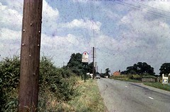Mid Sixties Welsh Border (colinfpickett) Tags: road rural countryside streetscene hedge lane telegraphpole