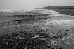 Stark (Lord-Chive) Tags: sea sky white mist storm black cold beach water weather stone wind estuary groyne humber