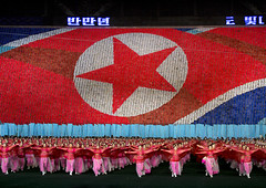 North Korean Flag During The Arirang Mass Games At May Day Stadium, Pyongyang, North Korea (Eric Lafforgue) Tags: show people color colour art sport festival horizontal illustration night asian creativity outdoors photography togetherness clothing education war asia nightshot symbol propaganda mosaic vibrant performance performing vivid happiness running celebration event photograph teenager mass multicolored awe patriotism performer northkorea joyous teamwork traditionalculture skill humaninterest pyongyang dprk nationalflag traditionalclothing arirang capitalcities choregraphy traveldestinations colorimage teamevent traditionalfestival northkorean colorpicture largegroupofpeople stagecostume democraticpeoplesrepublicofkorea artscultureandentertainment annualevent massgames celebrationevent maydaystadium peopledrawing performingartsevent massgame rungrado largegoupofpeople arirangmassgame cardflipper humanfresco pictorialmosaic eti4450
