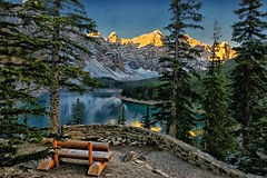 Bench at Lake Moraine (Phil's Pixels) Tags: canada sunrise reflections dawn bravo alberta soe daybreak gettyimages rockpile thebench tenpeaks banffpark benchatlakemoraine