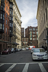 Downtown Boston (LunaticDesire) Tags: road street old city trip travel blue houses homes windows winter sky urban usa house holiday building brick cars tourism boston architecture america buildings ma photography bay living us office nikon apartments cityscape exterior view unitedstates massachusetts united unitedstatesofamerica north restaurants center tourist tourists sash shops northamerica states february condos dslr stores streetscape offices d40 2013