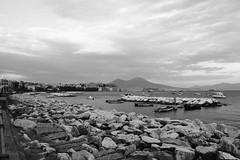 The colorless beauty (antoniorossi4) Tags: naples mergellina sea beautifulplace whiteandblack vesuvio sky rock gloomy boat gull cloud wind afternoon