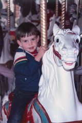 Michael on the Carousel - c1984 (kimstrezz) Tags: 1984 michael carousel carouselhorse merrygoround familytriptodisneylandc1984 disneyland anaheimca