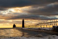 Winter Pier and Lighthouse Light (matthewkaz) Tags: grandhaven pier lighthouse grandhavenlighthouse lakemichigan lake water greatlakes sky clouds ice snow winter sunset michigan 2016