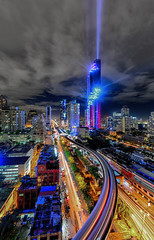 Mahanakhon a building that has the highest in Bangkok,Thailand.The building was opened spotlights. On the opening day of the tallest building in Thailand on August 29, 2016. (Aor Chantip) Tags: millionaire modern money new mall mahanakhon highest highrise luxurious luxury office prospective tallest tower urban view tall street residential rich shape skyscraper high financial center city cityscape commercial business building architecture area background bangkok company complex district economics exterior finance design corporate condo condominium construction apartment