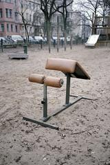 Untitled (Florian Thein) Tags: berlin kreuzberg spielplatz playground sand sandkasten trainingsgert bank bodybuilding sport film analog 35mm yashicat5 agfavista