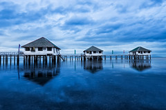 A Different Fairy Tale (arcreyes [-ratamahatta-]) Tags: morning blue sea reflection water clouds sunrise reflections relax still day cloudy philippines peaceful resort huts hour bluehour batangas stilts calatagan resthouse 2013 arcreyes