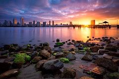 Sunrise Phenomenon (boingyman.) Tags: travel colors skyline sunrise canon landscape rocks cityscape sandiego dusk scape 1022 coronadoisland t2i boingyman