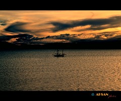 Destiny (Ahsan. (Busy..)) Tags: she sunset newzealand sky orange cloud brown sun lake black love me nature water beauty skyline clouds contrast canon dark skyscape photography freedom evening boat interesting focus soft tears alone loneliness colours shadows dof heart infinity happiness memory lonely effect betray distinct eka canonef24105mm  canon7d bhalobasha ekaki