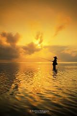 Fisherman_01 (krishmahaputra) Tags: bali silhouette sunrise canon indonesia fisherman sanur