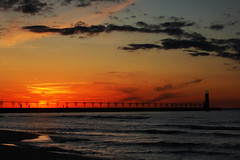 Manistee sunset (Notkalvin) Tags: sunset lighthouse beach beautiful pier warm michigan shoreline relaxing lakemichigan serene manistee notkalvin