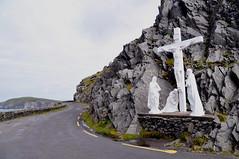 Irish coastal road (Grey travel) Tags: road ireland mountain statue rock danger religious shrine europe cross symbol accident dingle crucifix coastline peninsula distraction coastalroad narrowandwinding