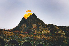 Fire Erupts (Sam Howzit) Tags: mountain japan fire disney erupt tokyodisneysea may2002 tokyodisneyresort mysteriousisland mountprometheus