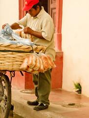 The bread man's pick (edwindejongh) Tags: door man bicycle work bread pain basket working granada redcap nicaragua pan job brot fiets brood mand deurpost stoeprand kadetjes rodepet redcapp onderdedoek