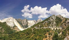 Travelling along winding and steep roads of the marble mountains (Bn) Tags: bridge blue trees roof summer chimney italy sun house mountains alps history abandoned rock stone clouds walking la