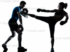 man woman boxing training (Franck Camhi) Tags: shadow two people woman white man male sports girl silhouette female training cutout pose person one coach exercise fulllength couples martialarts bodybuilding indoors whitebackground boxer studioshot posture boxing bodybuilder workout fitness adults isolated position trainer aerobics kickboxing gymnastic caucasian personaltrainer boxinggloves exercising aerobicinstructor combativesport