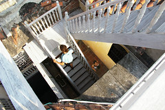 Cartagena stairwell (Tony Merryweather) Tags: travel building architecture stairs wooden colombia colonial stairwell colonialarchitecture restoration caribbean cartagena afternoonsun disrepair roofterrace
