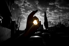 Catch the Sun (Nikiu) Tags: sunset sky blackandwhite sun clouds hand bardhezi