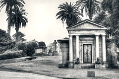 Resting in the City of Souls (PeterThoeny) Tags: cemetery cypresslawnmemorialpark sanfrancisco bayarea 3xp raw hdr nex6 photomatix sel50f18 day rainly rain sanfranciscobay colma california mausoleum outdoor garden architecture qualityhdr qualityhdrphotography column palm plant palmtree tree fav100