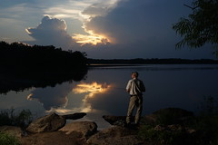 Micah fishing till dark (ralph_harp) Tags: offcameraflash fishing reflection strobe sunset nature