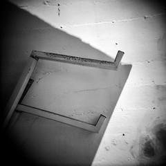 Downspout (robert schneider (rolopix)) Tags: downspout pacificgrove california ca calif rolopix robertschneider film monochrome blackandwhite bw kodak tmax 400 tmax400 tmy tmy2 mediumformat 120 120620 6x6 holga 120s toycamera plasticcamera square blur urbanlandscape wall shadows patterns geometry believeinfilm bwfp autaut