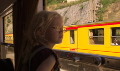 Petit Train Jaune #7 (tortipede) Tags: sony a500 1870 zoom fromraw rawtherapee holiday france frana midi migjorn catalunyadelnord catalunya catalonha catalogne roussillon rossell rosselhon petittrainjaune petittrengroc littleyellowtrain train narrowgauge electric pyrenees pyrnes pirineus child girl aphrascottbuck geotagged geo:lat=4251369 geo:lon=218812