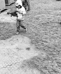 La Brea Tar Pits (Robert Borden) Tags: bw westcoast california socal la losangeles labrea tarpits lacma dinosaur bird child boy play iphone