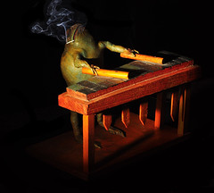 The Marimba Player (Bill Gracey) Tags: lighting cigarette smoke hard frog smokey rana 130 stuffedfrog cigarettesmoke directionallight hardshadows frogband frogmusician creativephotocafe shadowsyongnuo rf603nstrobie