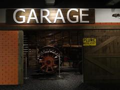 Garage (Home Land & Sea) Tags: nz newzealand palmerstonnorth temanawa museum exhibit garage old fordson major tractor sign plume motorspirit photoshop photomerge sonycybershot dschx100v pointshoot homelandsea