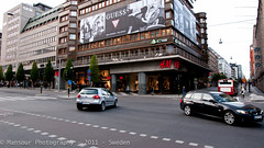 Street view (Mansour Obaidi - Photography) Tags: street building car vw golf sweden stockholm guess bmw intersection hm       mansourobaidi