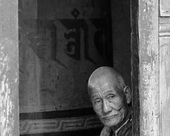 Kyichu temple - some faces look better in black and white (10b travelling) Tags: bw monochrome asian temple blackwhite asia asien dragon bhutan kingdom nun prayerwheel asie himalaya thunder himalayas templo bhoutan himalayan tempel 2010 butan kyichu drukyul peopleset peoplefamilycarstentenbrink placesasiabhutan cmtbbw