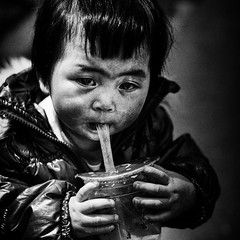 child of the alley~ Shanghai (~mimo~) Tags: china street old city people cup girl face square photography eyes alley asia child shanghai portait young straw gritty plastic mimokhair condemnedneighborhood