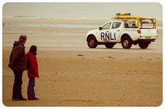 Look dear, could that be the RNLI? (Bev Goodwin) Tags: england beach liverpool couple crosby antonygormley rnli merseyside anotherplace crosbybeach sonya37