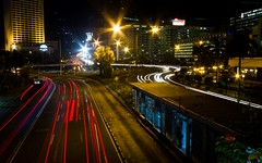 Busway (Matthew Kenwrick) Tags: city longexposure blue red yellow night dark indonesia traffic wideangle gritty jakarta lighttrails colourful 1022mm eos7d