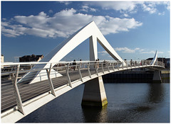 Squiggly bridge (GWMcLaughlin) Tags: uk bridge blue sky reflection water clouds river scotland clyde architechture glasgow squigglybridge