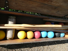 Croquet (2) (redpopcreative) Tags: grass box traditional colonial balls games soil dirt british mallet croquet spheres establishment aliceinwonderland mallets lewiscarroll woodenbox croquetmallet traditionalsport vintagegames traditionalgames croquetset britishestablishment colonialpastimes gamesongrass