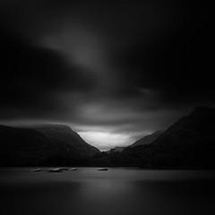 the lake II (Andrew J Lee) Tags: uk longexposure water wales square boats mono blackwhite moody llanberis northwales contemporaryartsociety