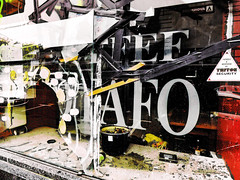 Trumpton Security (Steve Taylor (Photography)) Tags: art digital black yellow white red broken cracked damage smashed glass newzealand nz southisland canterbury christchurch cbd city tape coffe cafe shop
