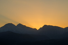 The beginning (Dejan Hudoletnjak) Tags: sun is rising behind mountains day waking up mountain sunrise rays sunrays
