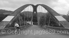 "REU700  ""Little Golden Gate"" Arch Bridge over the Reuss River, Root, Canton Lucerne, Switzerland (jag9889) Tags: 2016 20160727 alpine archbridge bw blackandwhite bridge bridges brücke ch cantonlucerne centralswitzerland crossing cyclist europe footbridge goldengate helvetia infrastructure innerschweiz kantonluzern lu lucerne luzern monochrome outdoor pedestrianbridge pont ponte puente reuss river root schweiz suisse suiza suizra svizzera swiss switzerland water waterway zentralschweiz jag9889"